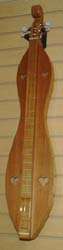 McSpadden scrollhead hourglass dulcimer - Cherry and Redwood with standard case available from Prussia Valley Dulcimer Acoustic Music Shop